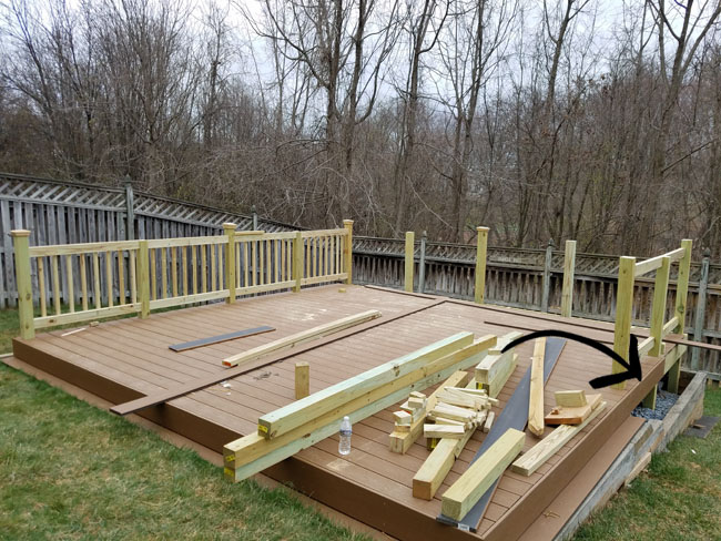 installing railing around deck and a flower box