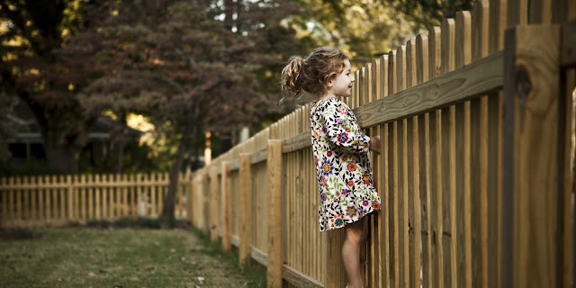 Child at fence