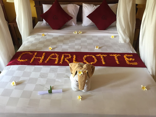 Kubuku hotel room bed with flower petal name, in Pemuteran, Bali, Indonesia