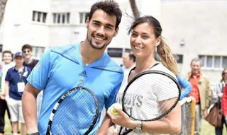 Fabia and his girlfriend holding rackets