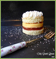 Individual trifle cakes layered with sponge, jelly, custard and cream