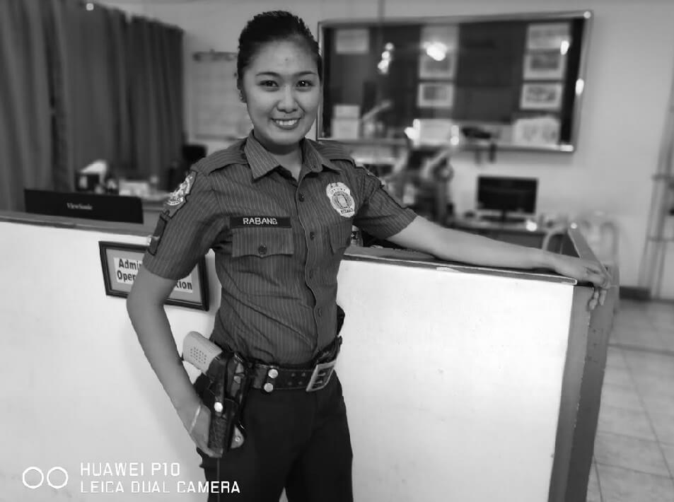 Febe Abang - a policewoman from Tondo; Photographed by Dookie Ducay