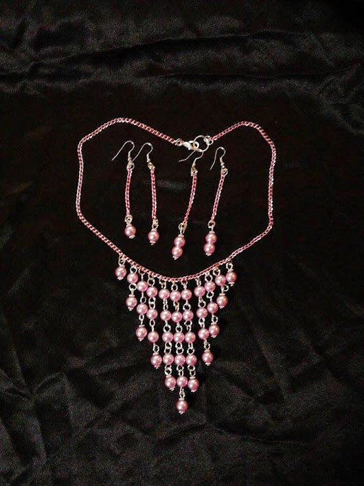 Necklace and earrings with pink pearls and pink chain