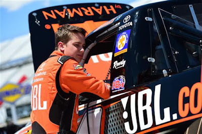 Christopher Bell (#4 JBL Toyota) stands in the garage area during practice in Dover, Delaware.