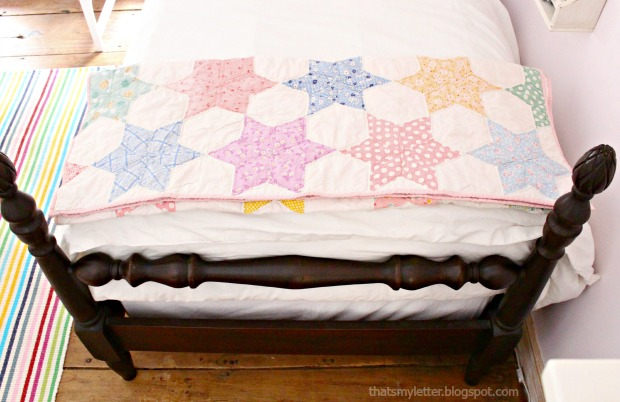 vintage quilt on girls bed