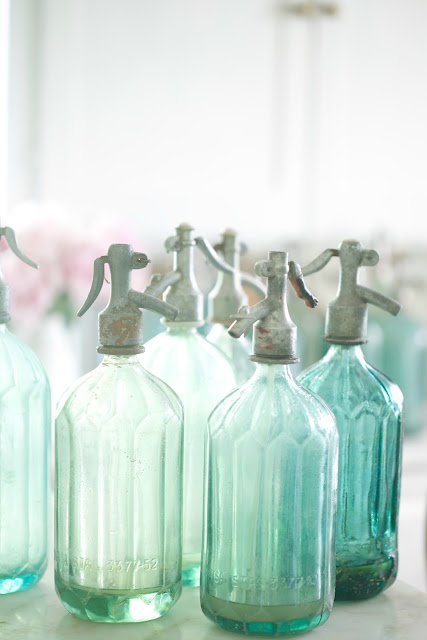 green and blue seltzer bottles