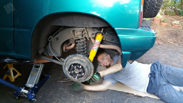 Andy installing new rear shock absorbers on the Suzuki Sidekick