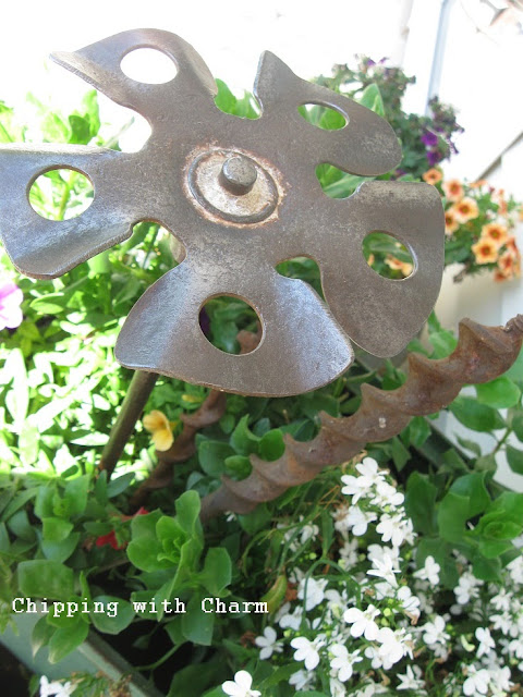 Chipping with Charm: Paint Stirrer Junk Flower...http://chippingwithcharm.blogspot.com/