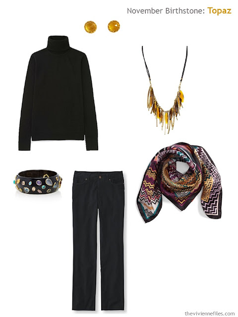 a black outfit with topaz and citrine accessories