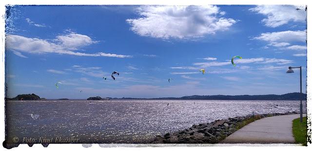 Fint vær og vind for kiterne i dag, hele 13 skjermer i luften, stor fart og mange flotte hopp, tøft :-) Bilde er fanget med mobilen 10.06-17, fra Revstien.