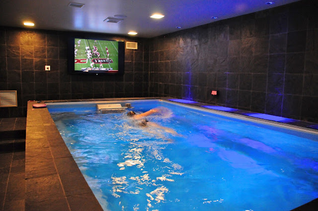 Man Cave with big screen television and Endless Pools swimming machine