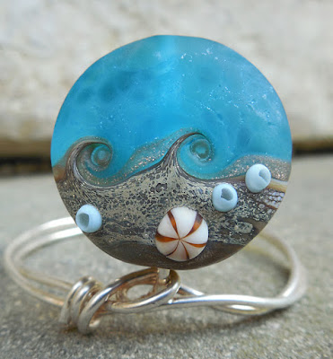 https://www.etsy.com/listing/398313059/beachcomber-12-ssl-lampwork-focal-bead?ref=shop_home_active_3