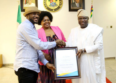 Tuface Idibia and Governor Akinwunmi Ambode with a certificate of Appreciation, for his selfless support to the growth of Africa's biggest awards, AFRIMA All African Music Award