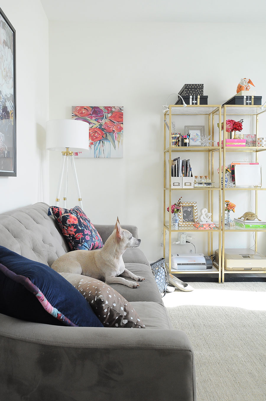 A small sofa serves as seating in this bright white and gold home office makeover.