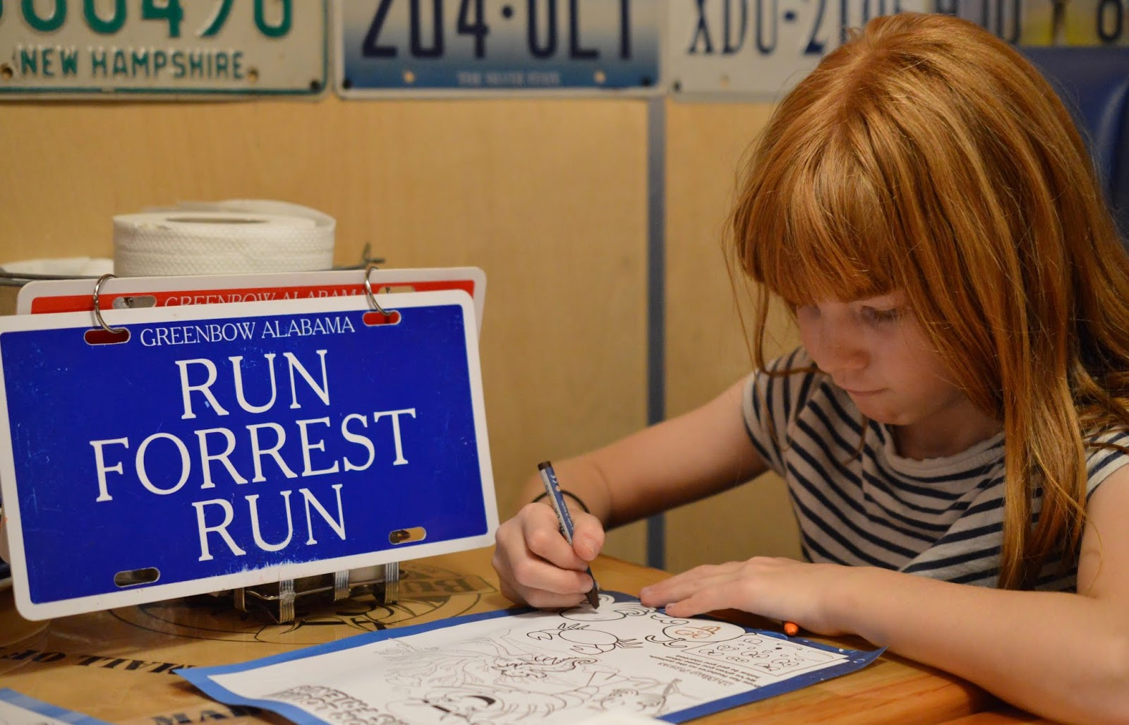 Dining with Kids in London | Bubba Gump Shrimp Leicester Square Review  - run forrest run sign