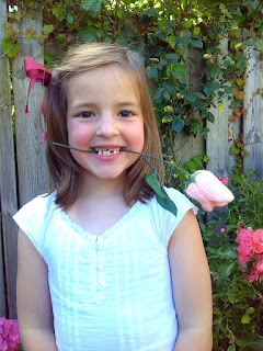 Girl with crochet pink Tulip Flower on plastic stem