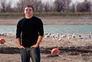 Cramer Imaging professionally created senior portrait of a young man with buoys at Jensen's Grove, Blackfoot, Bingham, Idaho