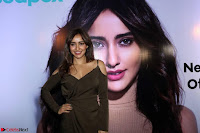 Neha Sharma Pos At Mobile App Launch 8.jpg