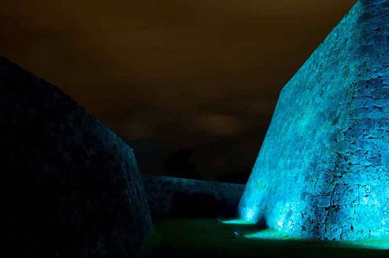 illuminated stone walls of castle