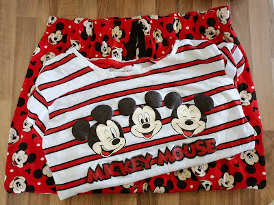 Red and white pyjamas with Mickey Mouse faces print