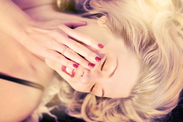 retro styled, soft focus, laughing, red lips and nails