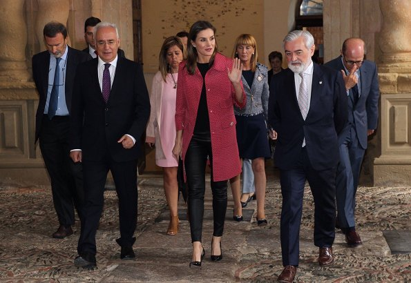 Queen Letizia wore Uterque Black leather pants and Uterque red coat. Queen Letizia wore Carolina Herrera black patent and suede pumps
