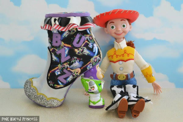 silver buzz lightyear ankle boot sitting beside jessie cowgirl large doll and sky wallpaper background
