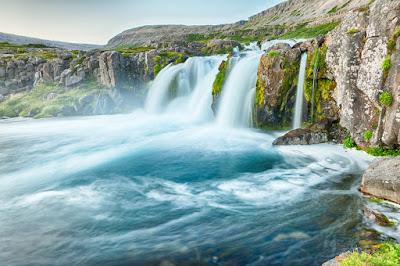 Blue waters at Dynjandi waterfall in July