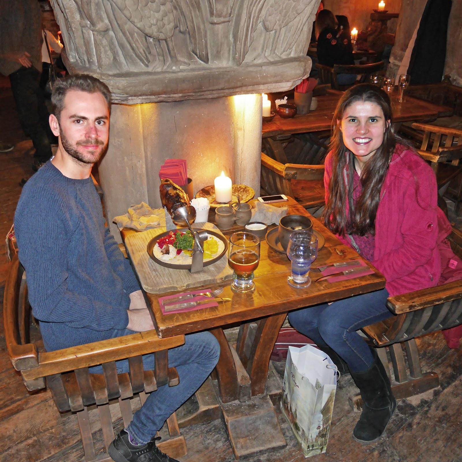 Kat Last and Stuart eating dinner at Rozengrāls Medieval Restaurant in Riga, Latvia