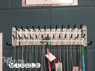 A tie and belt holder can be the perfect compact place to store brag tags.