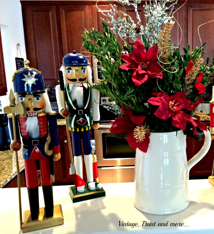 Vintage, Paint and more... vintage nutcrackers with an ironstone pitcher filled with Christmas flowers