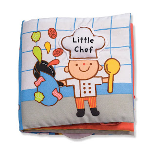 A soft baby book titled little chef.