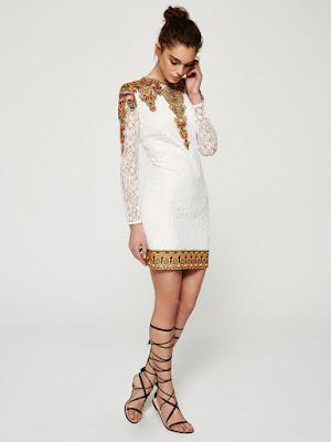http://www.mioh.eu/collections/vestidos-primavera-verano-2016/products/nilo-blanco-vestido-corto-de-encaje-de-manga-larga-con-bordados-de-colores