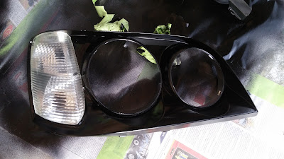 lh headlight inner surround black gloss