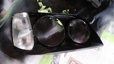 lh headlight inner surround black gloss