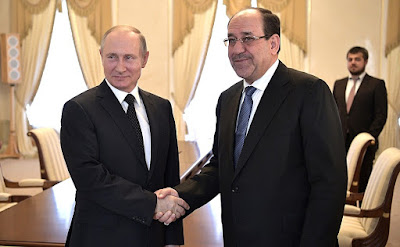 Vladimir Putin with Vice President of Iraq Nouri al-Maliki.