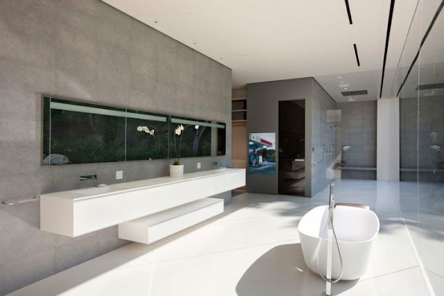 Picture of the minimalist bathtub and sinks on the wall