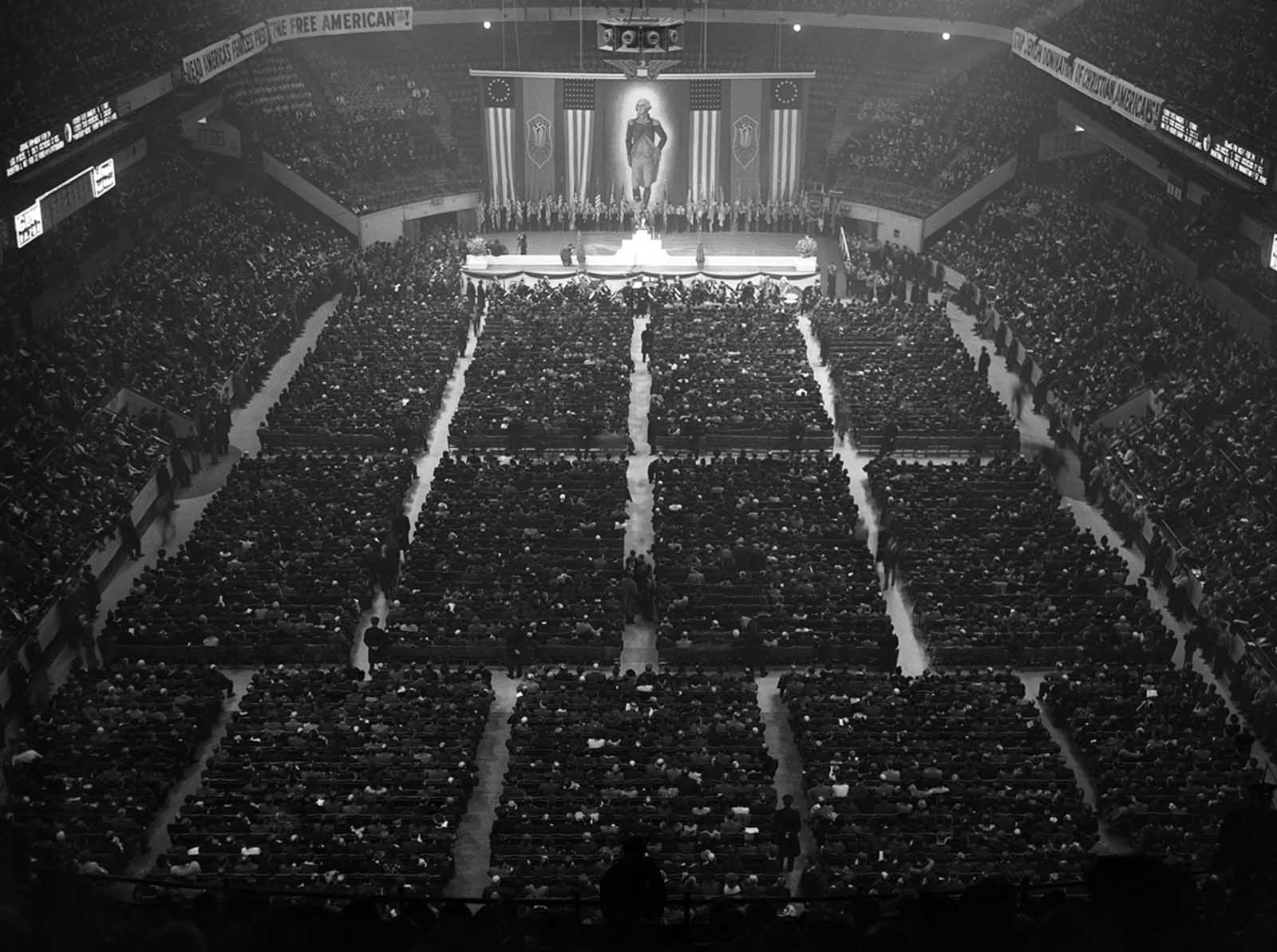 A crowd of approximately 20,000 attends a German American Bund Rally at New York's Madison Square Garden on February 20, 1939. At center is a large portrait of George Washington, claimed as an icon by the Bund, who called him