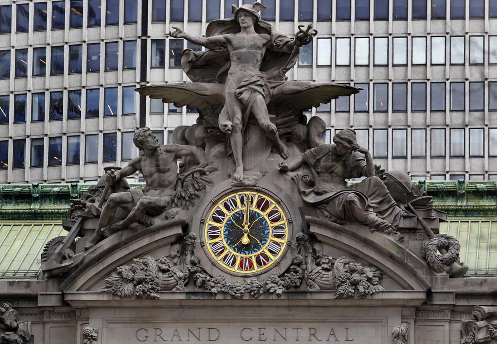 The clock on the south-facing side of New York's Grand Central Terminal strikes noon, on March 29, 2012.