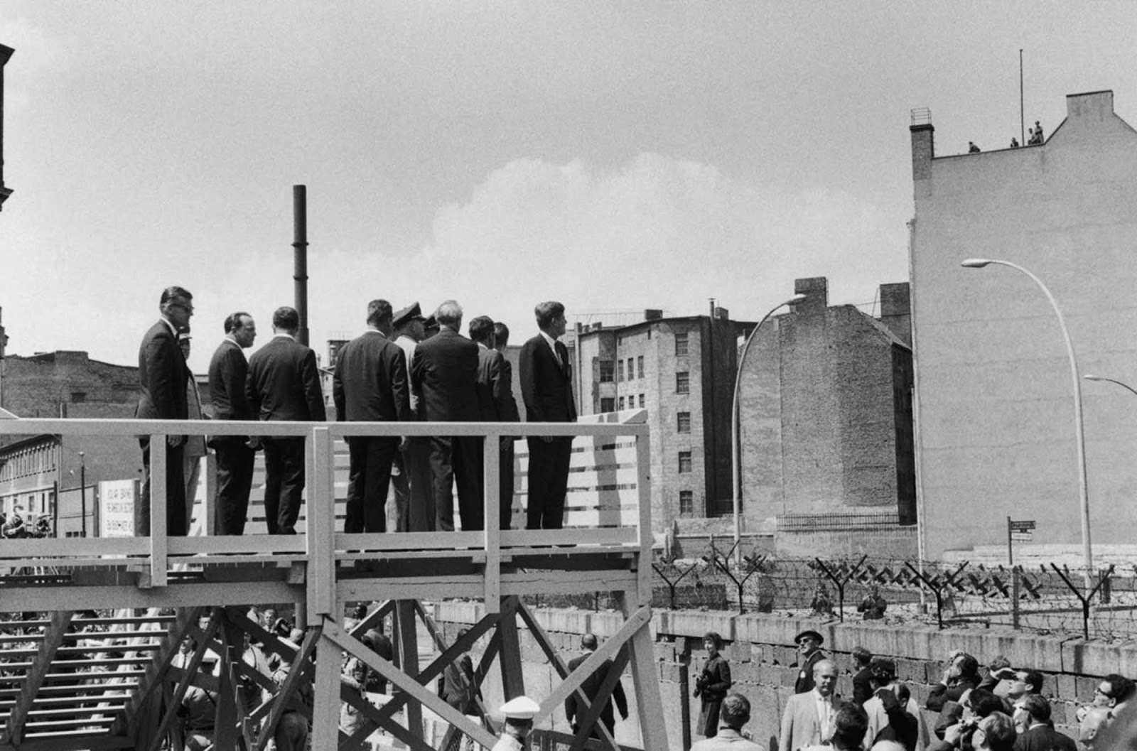 Kennedy surveys the Berlin Wall from a special viewing platform.