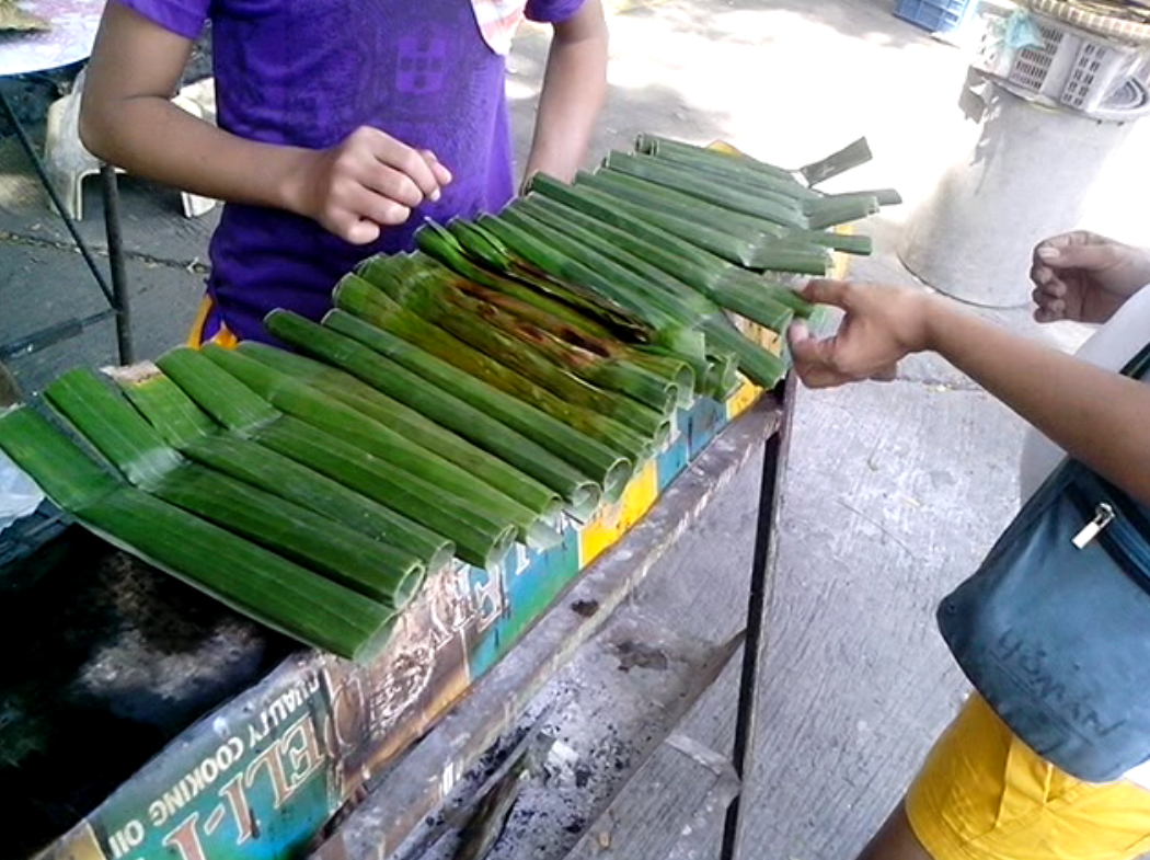 "Buy the delicious Manaoag ""tupig"" by the dozens."