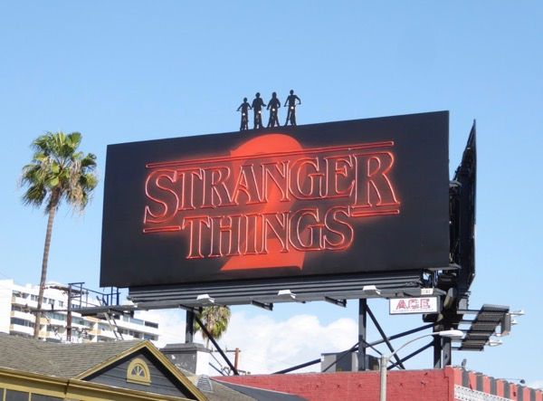 Stranger Things 2 neon billboard installation daytime