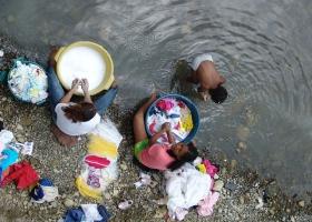 Washing clothes at the river.