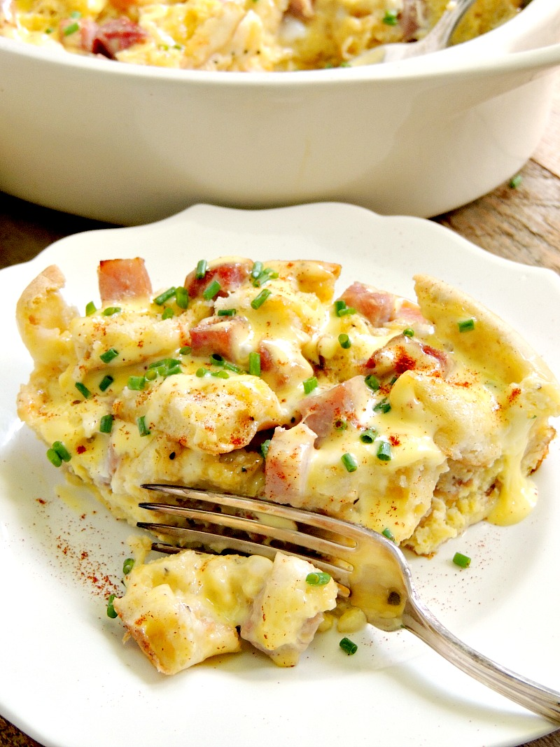 Impress your family and friends with this easy Eggs Benedict Breakfast Casserole. It is perfect for the holidays, Mother's Day, or just a fun family weekend breakfast. From www.bobbiskozykitchen.com #breakfast #eggs #casserole #easy