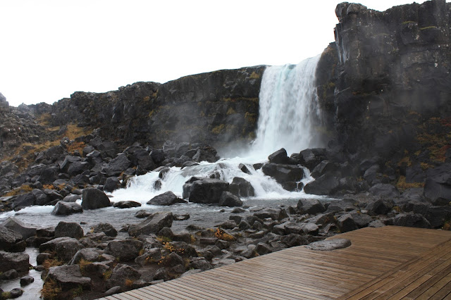 A lovely waterfall provides a scenic backdrop in Thingvellir in Iceland.