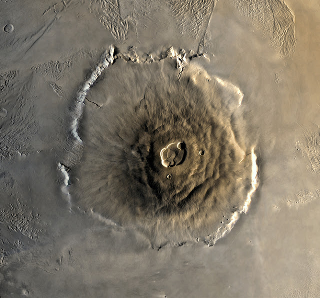 Olympus Mons is three times higher than Mount Everest and about the size of France.  NASA