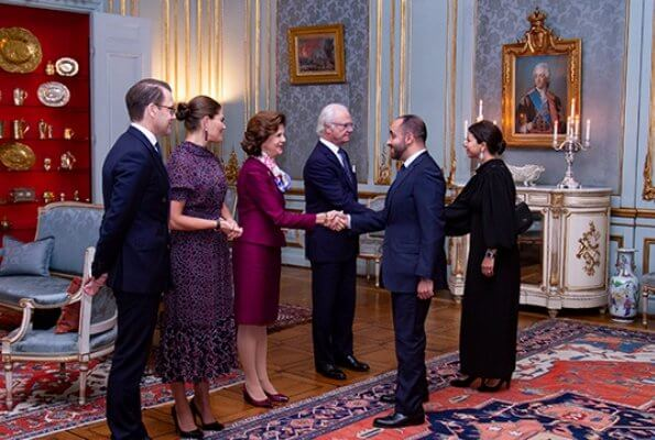 Crown Princess Victoria wore By Malina Lysandra dress. Queen Silvia wore burgundy satin suit