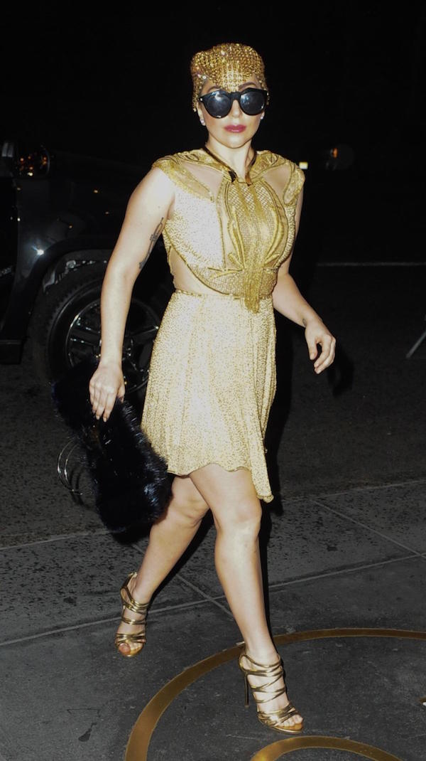 Lady gaga,  New York City in gold dress and a golden hat with dark glasses , sexy look