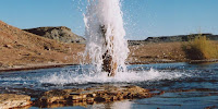 A cold water geyser from an unplugged oil exploration well drilled in 1936 into a CO2 reservoir in Utah, US. (Image Credit: Mike Bickle/Cambridge Centre for CCS) Click to Enlarge.