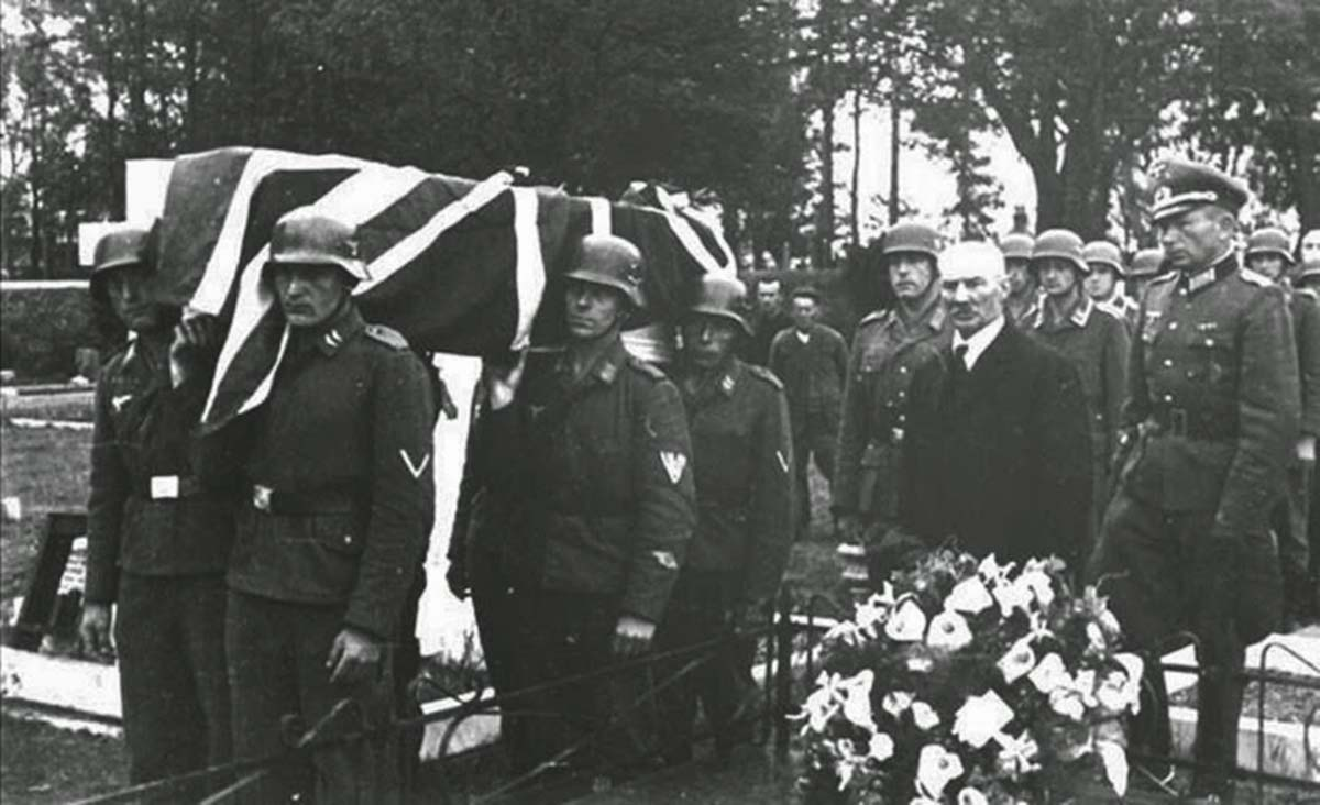 A RAF airman is buried with full military honors by occupying German soldiers, 1943.